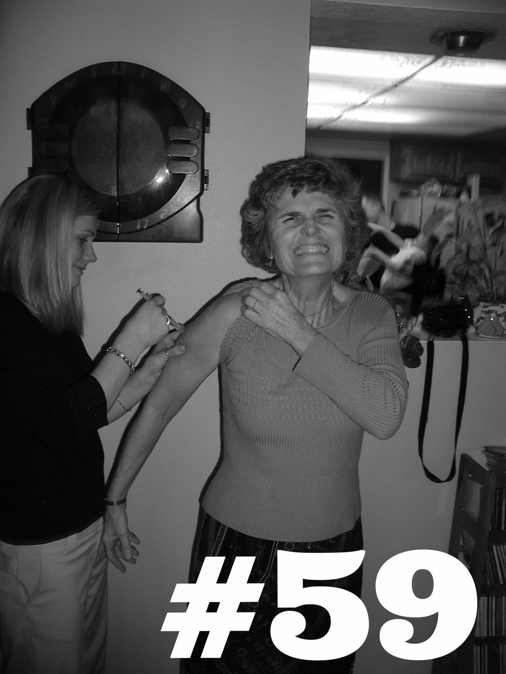 Covina, CA. Nurse Julie jabs Aunt Carol. Holiday flu shots! 2002