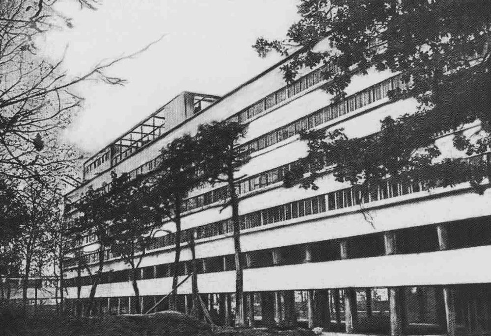 the rear facade of Narkomfin in Moscow, shortly after completion in 1930.