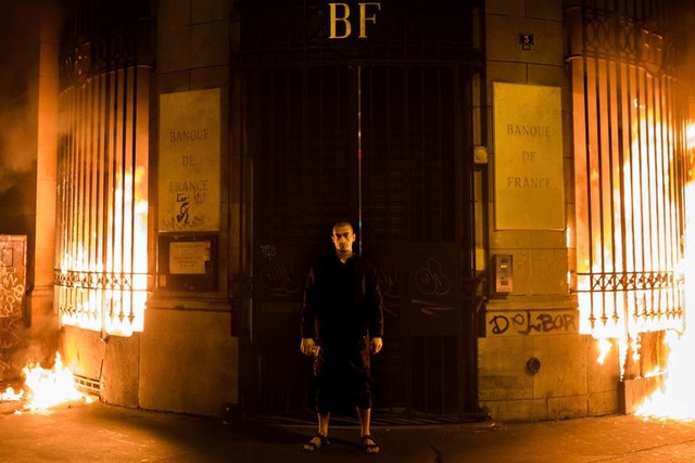Petr Pavlensky in front of a Banque de France building in the Place de la Bastille in Paris. Photo in The New York Times, Oct. 19, 2017