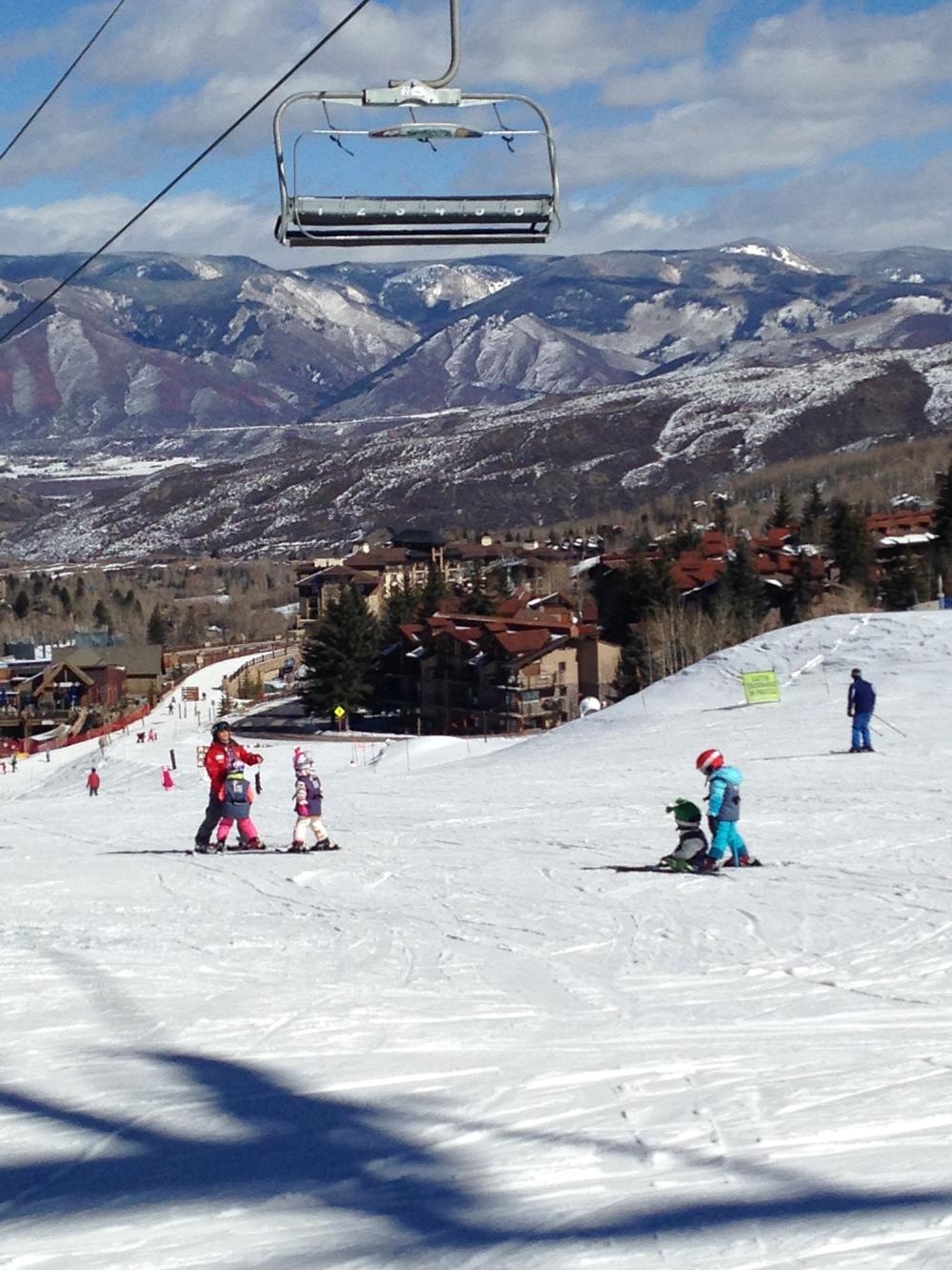 Snowmass ski school kids taking a run down Skittles.