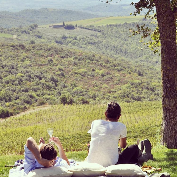 Our travel director, Monique, casually poses with her hubby at one of our fave Tuscan destinations, Castiglion del Bosco.