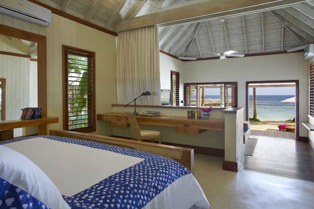 Goldeneye, One bedroom Beach Villa from bedroom looking out - Christian Horan.JPG