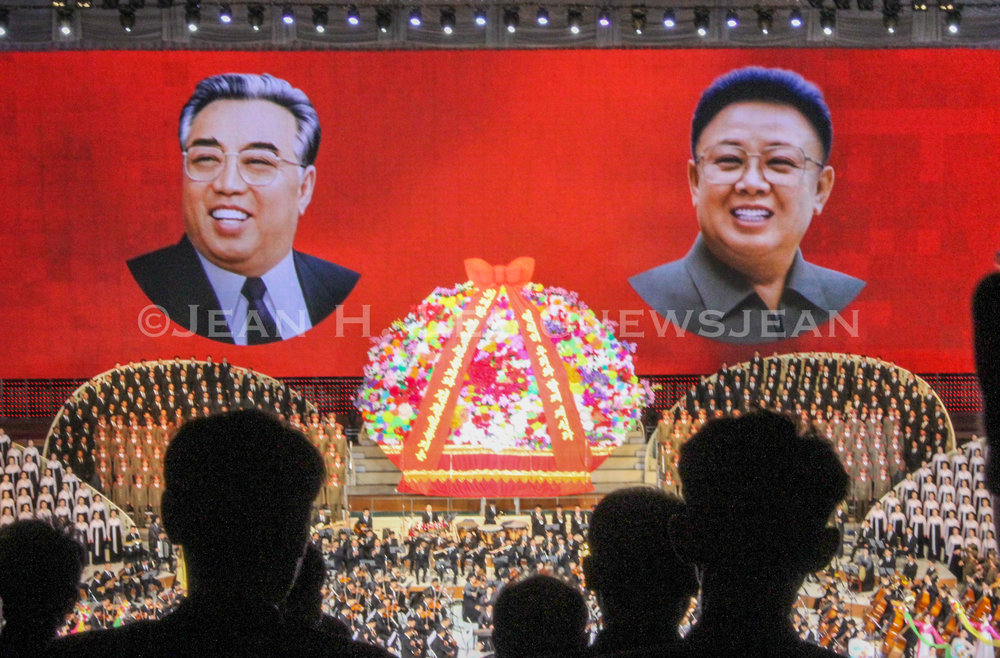 PYONGYANG, North Korea — The late North Korean leaders Kim Il Sung and Kim Jong Il are projected at a performance in Pyongyang, North Korea. (Photo credit: Jean H. Lee. All Rights Reserved.)