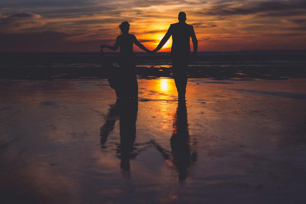 Walk on beach at sunset