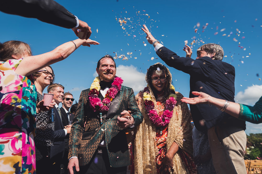 Confetti action at Bengali wedding