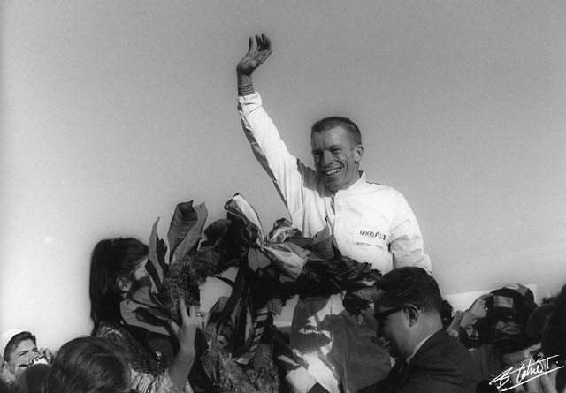 Ginther at the 1965 Mexico Grand Prix, winning his only F1 race, and the first for Honda