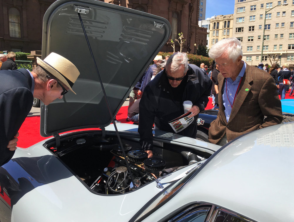 A small group gathers around a 1958 AC Bristol driven by Van and Merrill Kasper of CA