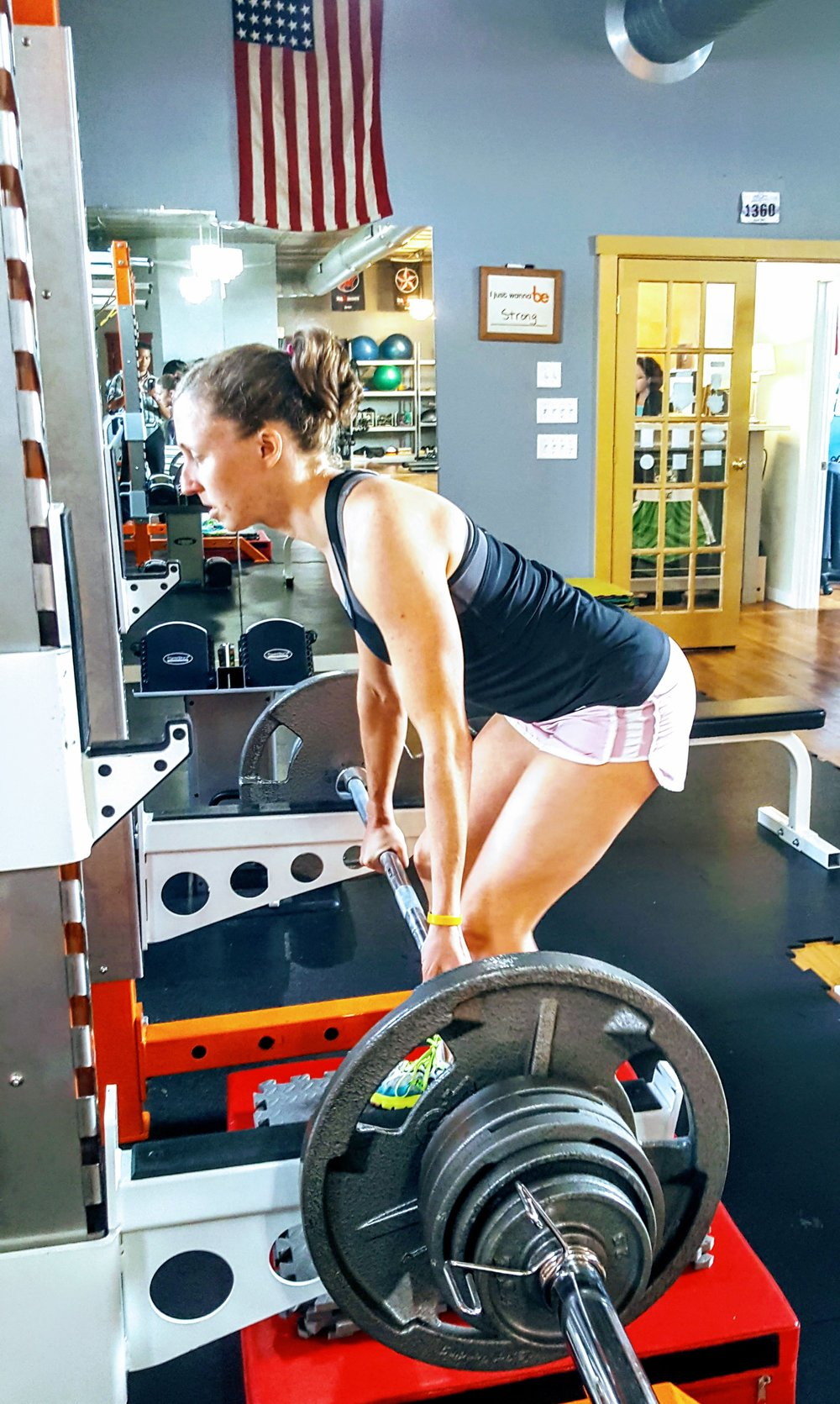 Jocelyn is performing a rack lift to strengthen the back, hamstrings, and gluteals--all muscles that are traditionally very weak in endurance athletes.