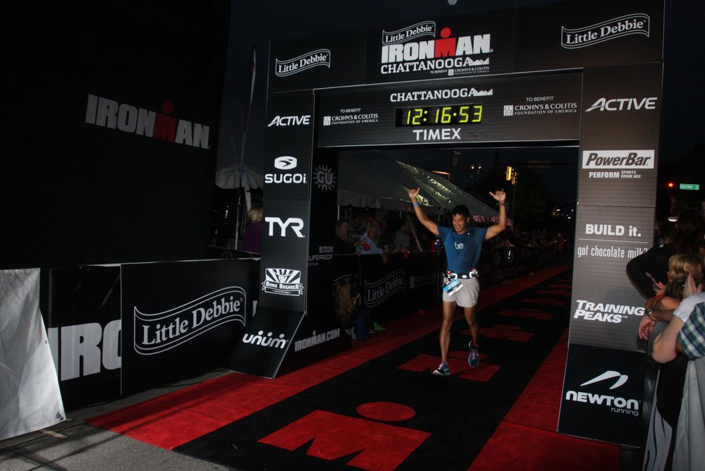 Eric finishing his first Ironman with a time of 11:55:37.