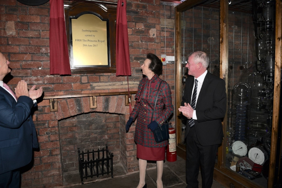Princess Anne and Graham Hall admiring the royal plaque