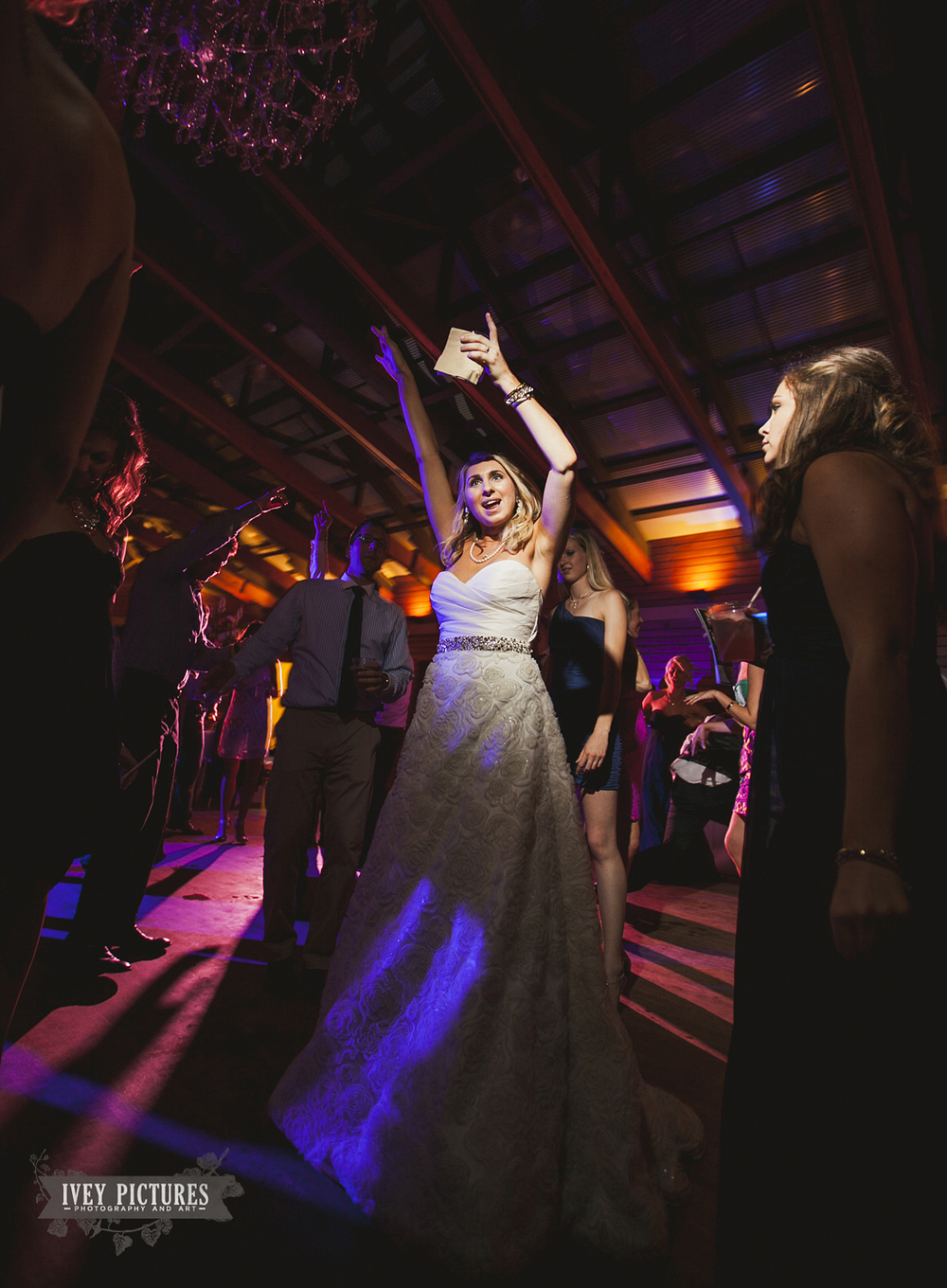 bride at reception dancing