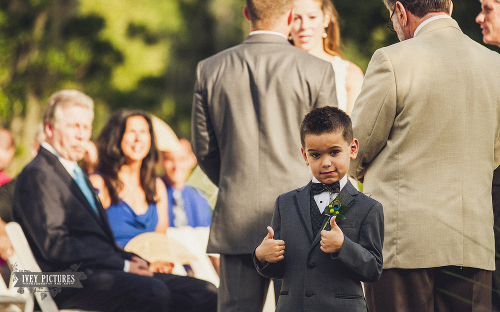 funny ring bearer photo during ceremony