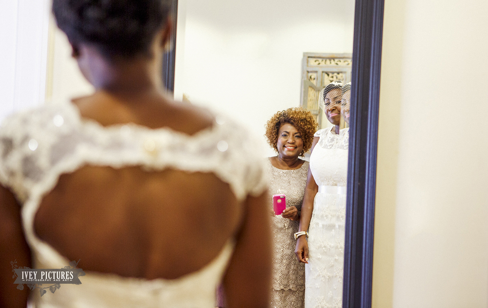 Bride and Mom looking in mirror