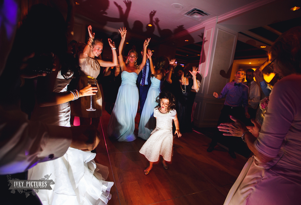 flower girl dancing at reception
