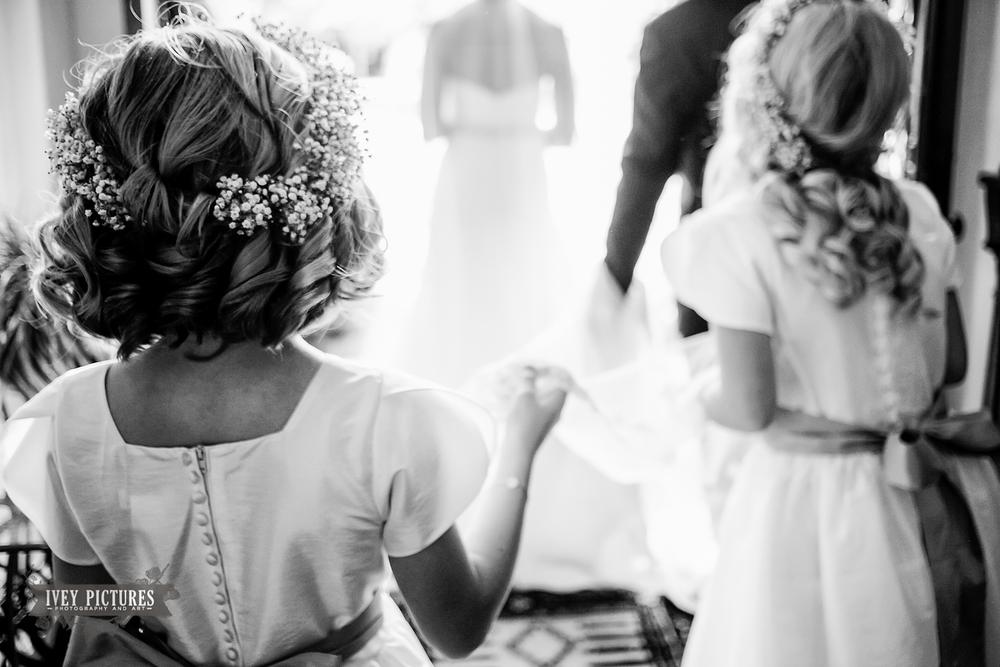 flower girl holding wedding dress