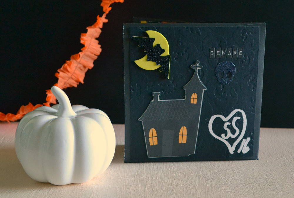 Tim Holtz little alpha stickers, cute haunted house from Tuesday Morning. Foam bat/moon from Dollar Tree and glitter skull from Wal-Mart. Love that embossed paper from Michaels!