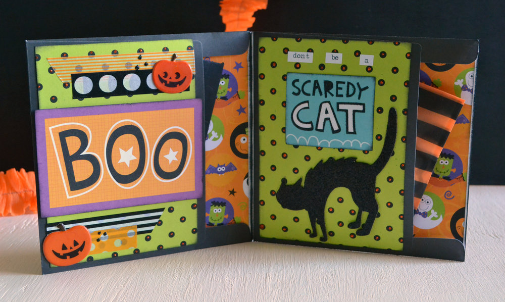 All the paper here is from Hobby Lobby (the current 2016 Halloween paper pad). Die Cuts and sentiments from a random pack I got at a scrapbook garage sale. Michae's and Target washi tape. Tim Holtz chitchat stickers, Stickles and some super cute pumpkin stickers from Tuesday Morning.