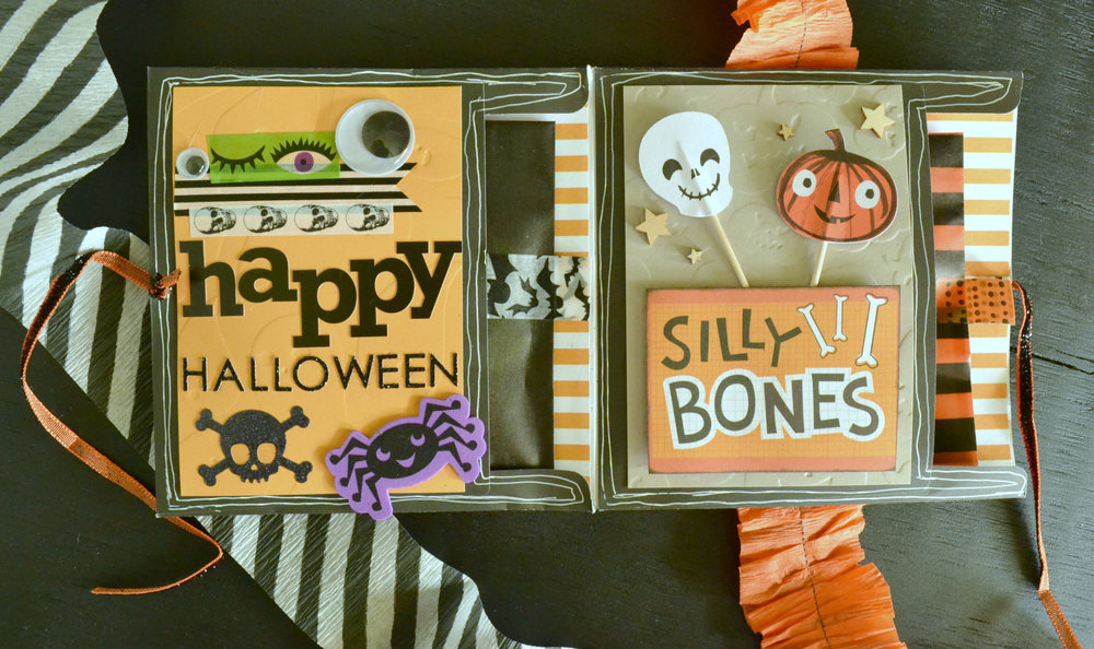 The cute skully and jack-o-lantern are cupcake picks/toppers! I love the idea of using them to add a bit of dimension to the piece.