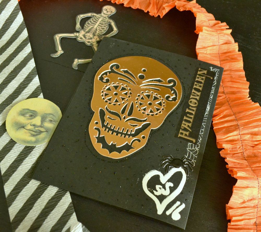 Still undecided on how I feel about these skull die-cuts I bought from Michaels this year. I like them in theory, but every time I use them I am sort of meh about the results. Hmmm.