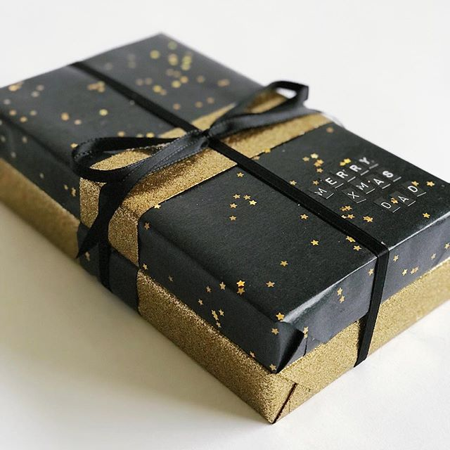 A stack of books, wrapped in contrasting #blackandgold #wrappingpaper from @target ⭐️⭐️⭐️ . . . #giftwrappingideas #giftwrapping #giftwrapped #prettypackaging #prettygift #giftwrap #customgift #wrappingpaper #giftpluswrap #christmasgift #christmaswrapping #glitterpaper