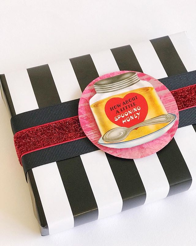 More #vintagegraphics from TheDigitalChick on Etsy, layered over some #gelliprinted cardstock and red glitter ribbon. If you haven't noticed yet, black and white stripes are my favorite thing. . . . #giftwrappingideas #giftwrapping #giftwrapped #prettypackaging #prettygift #giftwrap #customgift #wrappingpaper #giftpluswrap #valentinesday #blackandwhite #gelliprint #vintagevalentine