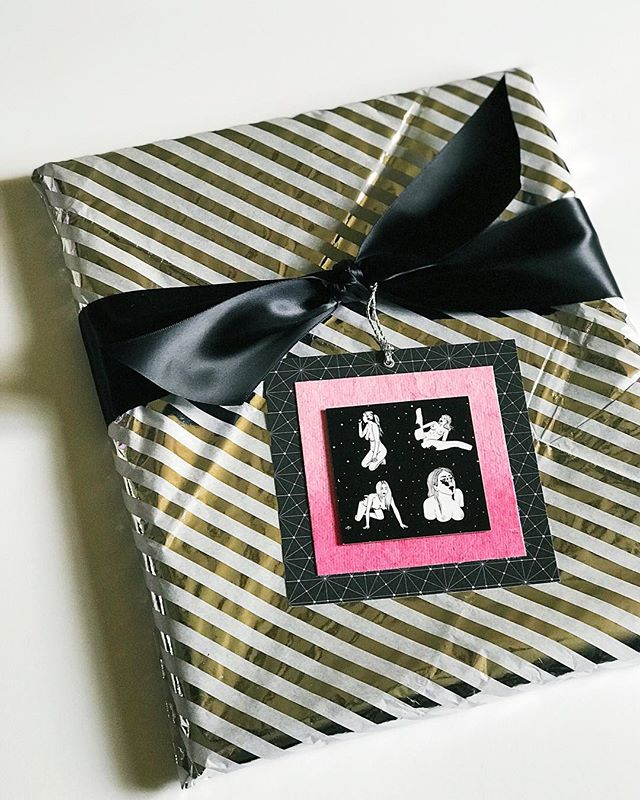 "A #valentinesday #giftwrapping commission featuring the bad-ass art of @melodieperrault 🖤💗🖤 another case for wrapping in #tissuepaper! This was a framed print which I wrapped first in bubble wrap and then in the tissue. Silver foil stripes fit in perfectly for ""space"" theme. Business card sent with the print was repurposed for the gift tag and I love how it turned out! . . . #giftwrappingideas #giftwrapping #giftwrapped #prettypackaging #prettygift #giftwrap #customgift #wrappingpaper #giftpluswrap #customwrapping #melodieperrault #ineedspace #giftwrappingservice"