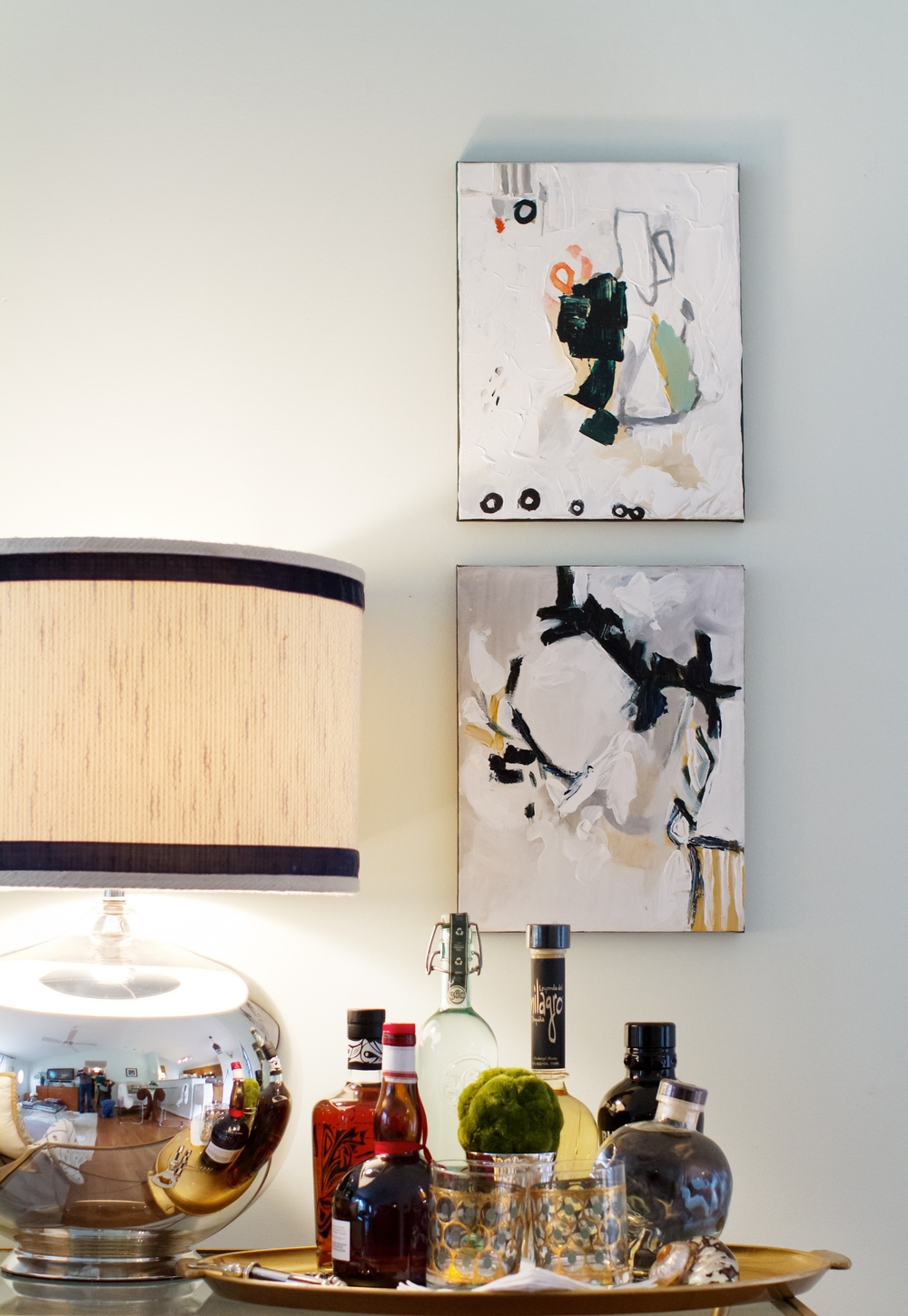 Velvet tape trim was added to a stock lamp shade to add a custom layer.  Abstract artwork punctuated the young couple's vibe.