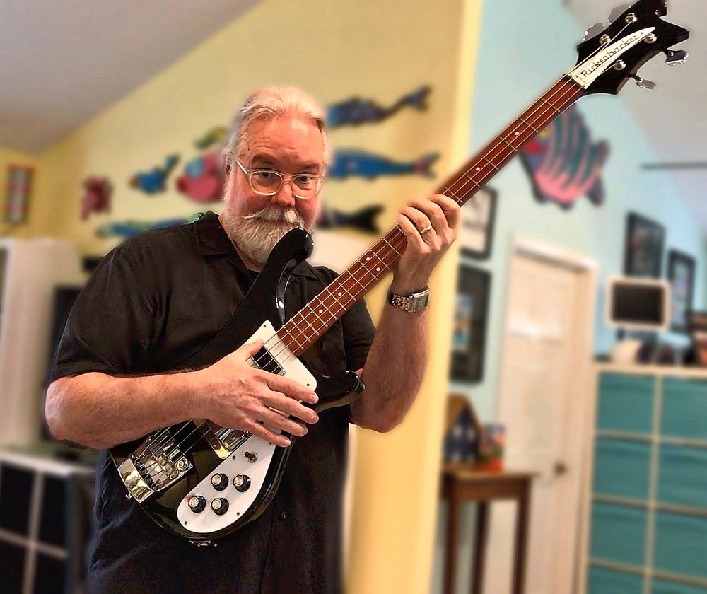 When he's not drawing or designing, Norris is rattling the windows with his bass guitar (much to the delight of the neighbors).