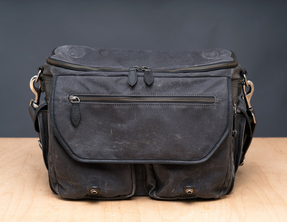 "The large ""fanny pack"" zippered pouch, as well as a clear view of the rivet snaps the twin straps snap down onto."