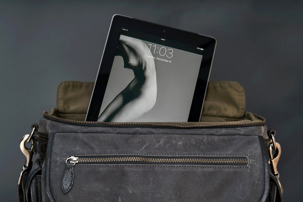 "A padded interior compartment easily fits an iPad, 12"" laptop or 13"" MacBookAir"