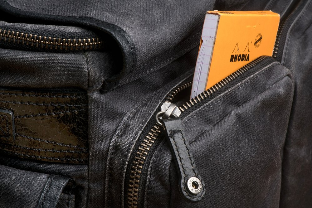 Dual zipper / pulls are outfitted on each of the large front pockets -- accessible from the top or bottom of the pocket. Each can also be snapped down securely to ensure the pocket doesn't get accidentally unzipped.