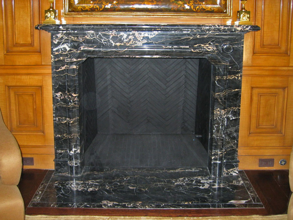 fireplace surround in nero potoro marble
