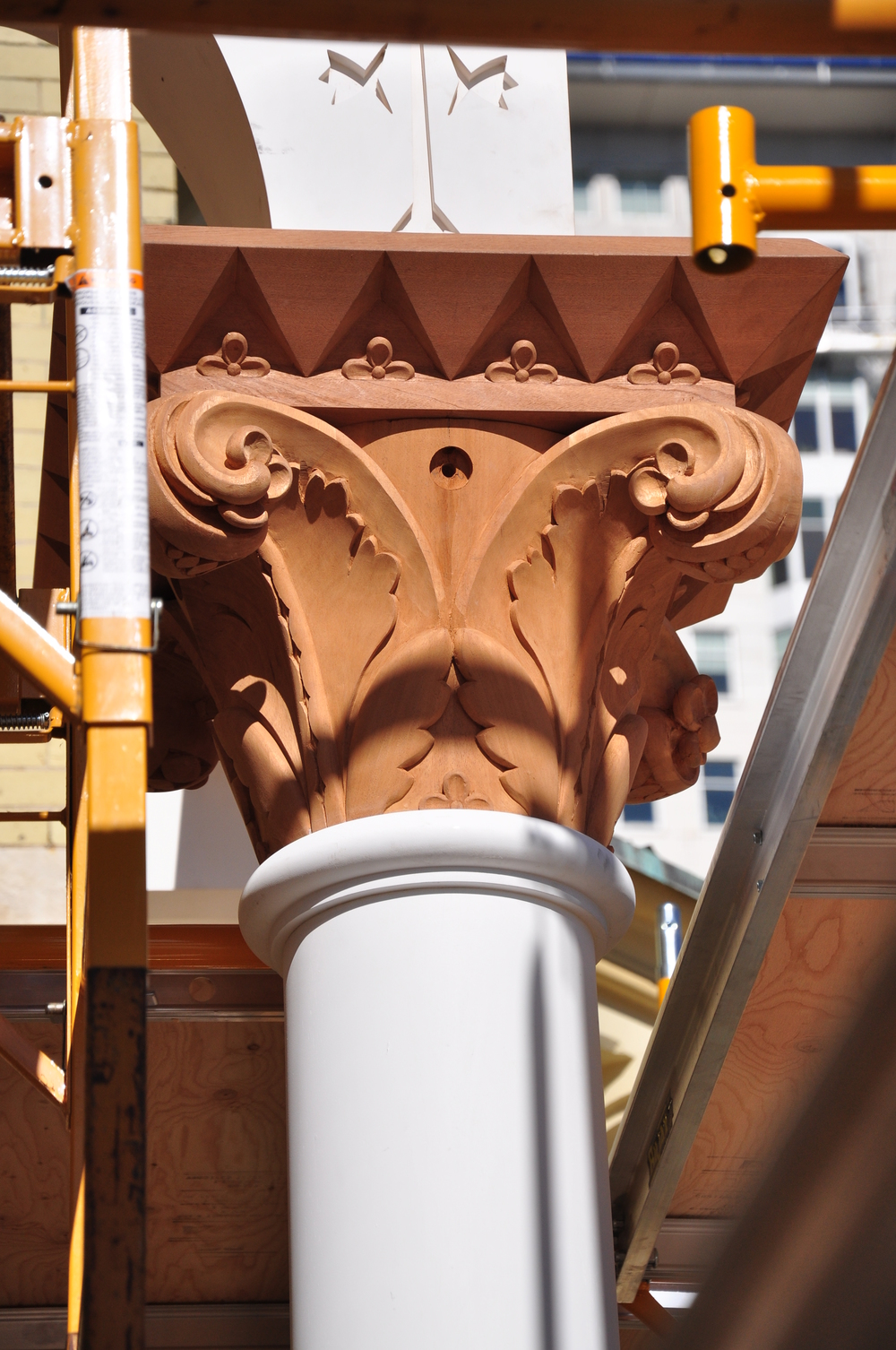 One of the full capitals during installation