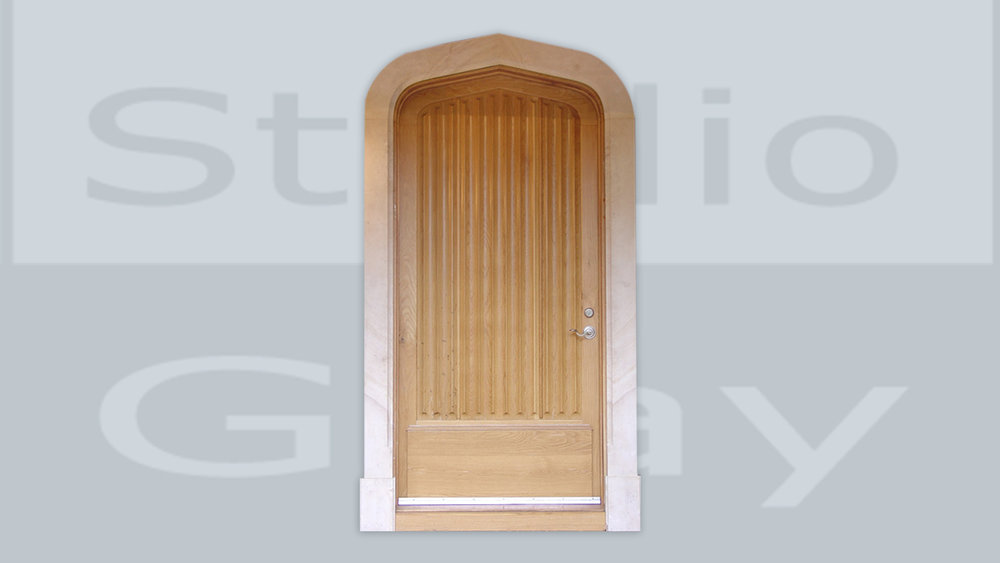 Door in White Oak and Beaumaniere Limestone Casing