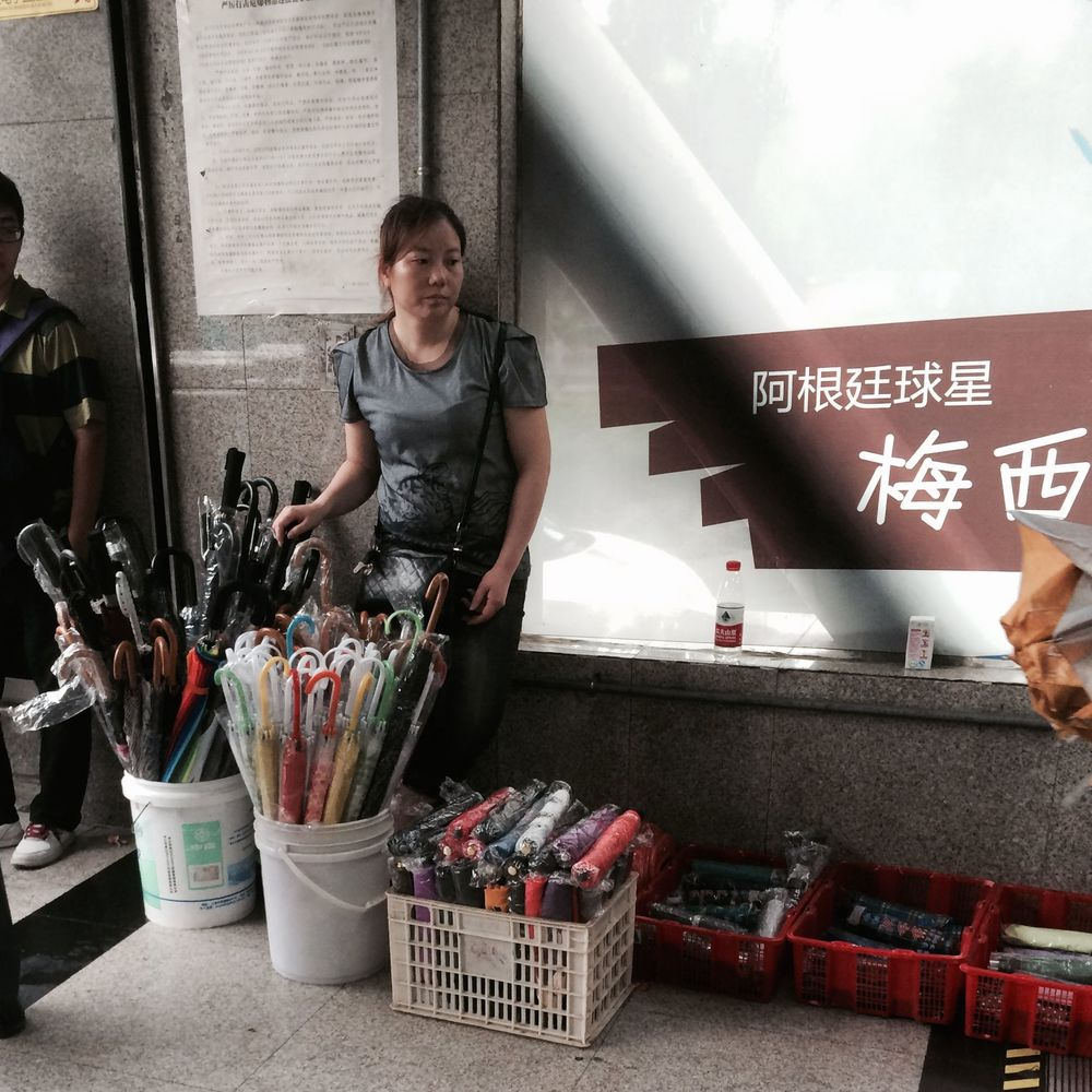 Umbrella Seller in Shanghai Subway Exit