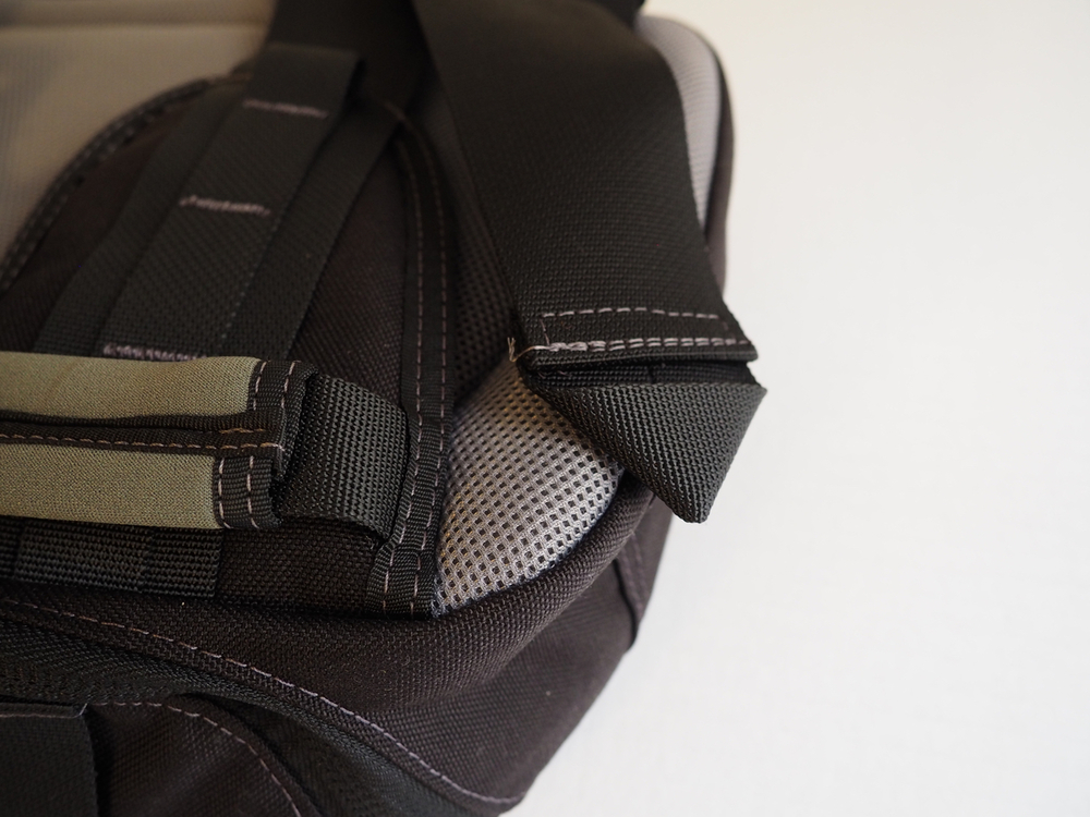 Note how the end of the strap is folded over into a triangle