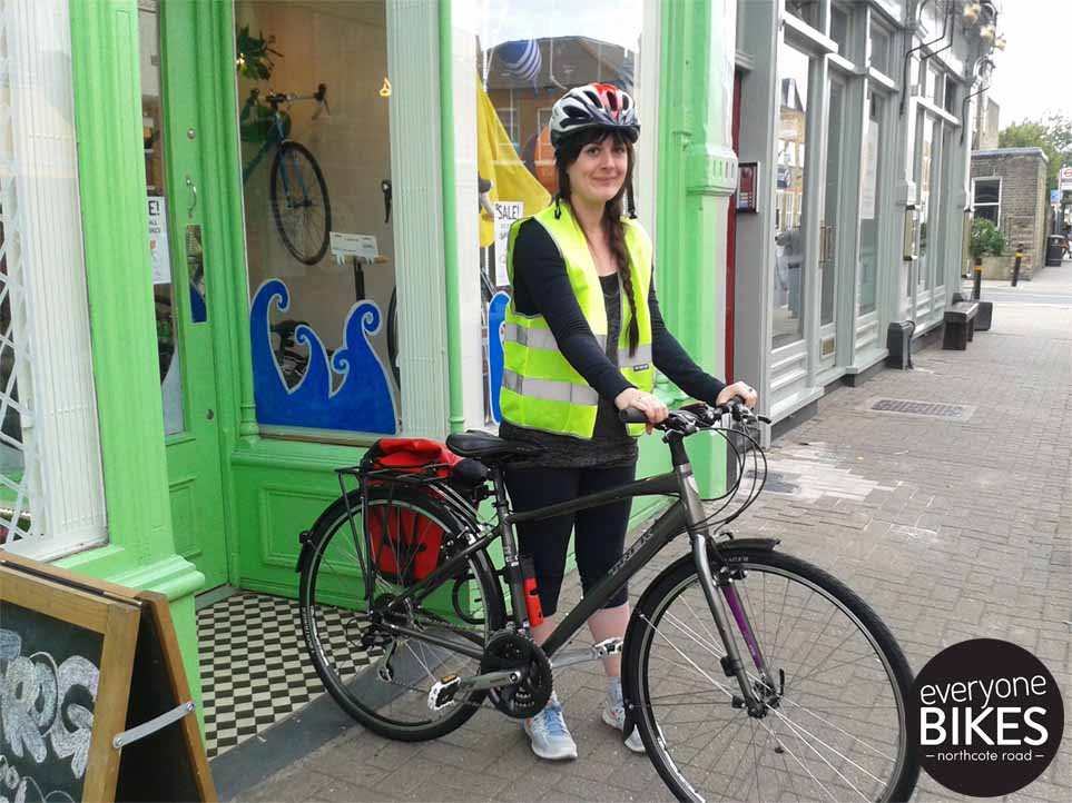 A very happy shopper with her new Trek Women 7.2 WSD, Bontrager Helmet, Ortlieb Bag, Abus Lock & More.