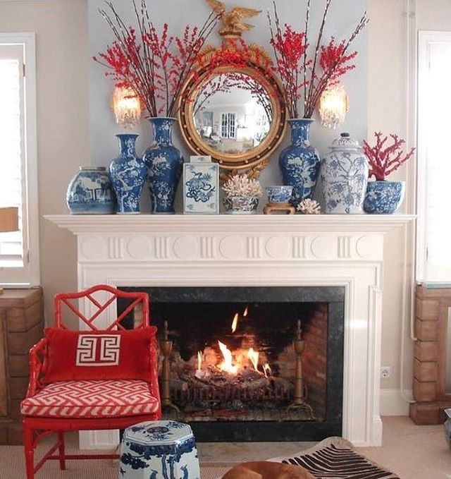 Love mixing my favorite blue and white with a pop of color. This fireplace mantel by @trellishomedesign is simply perfect!