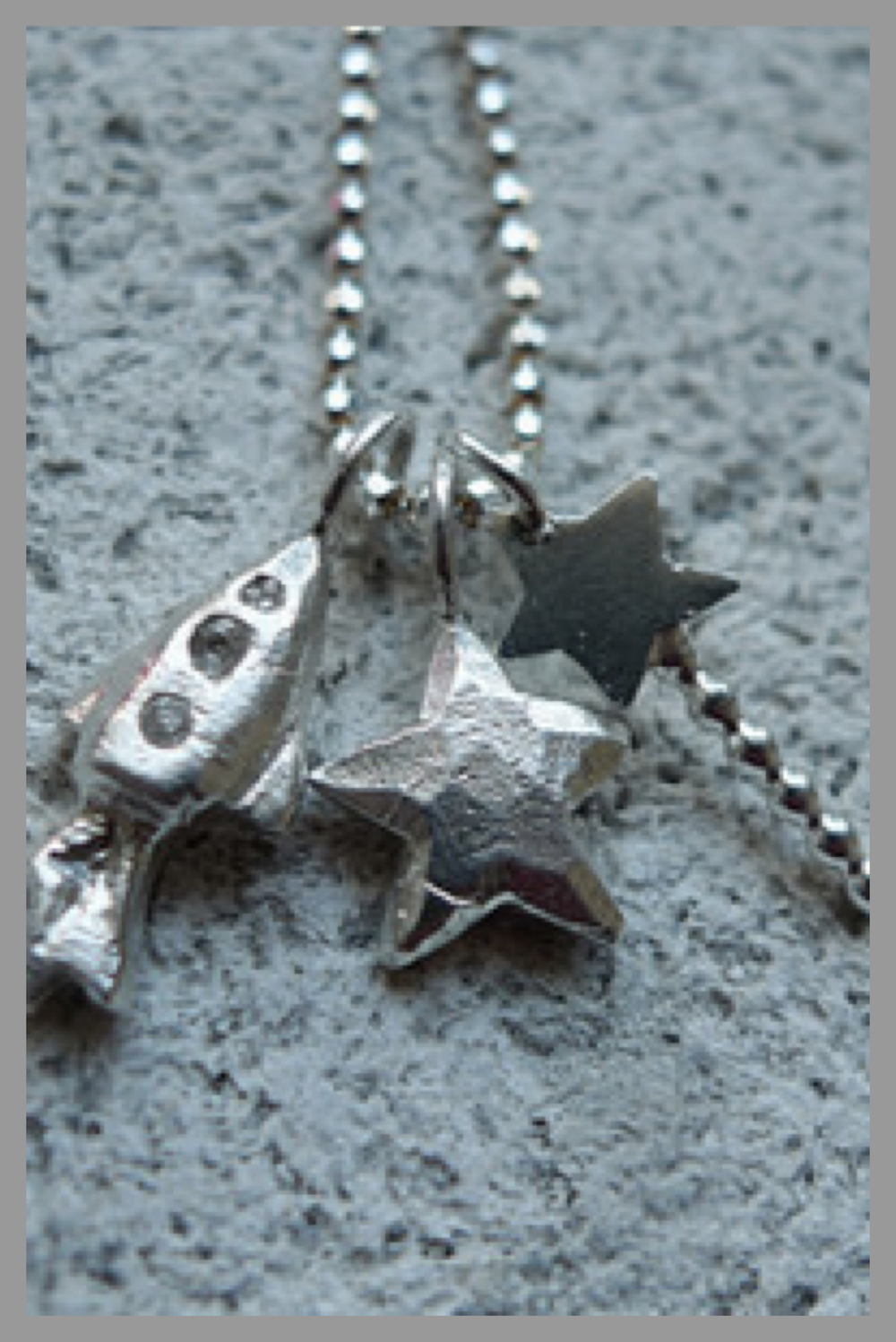 "Blue Skye Thinking Charm Necklace This customised hand carved rocket ship, star, and magic wand charm is cast in sterling silver and hangs on an 18"" sterling silver faceted ball chain. To order, click the link above! 50% of the fee is given to the Charity."