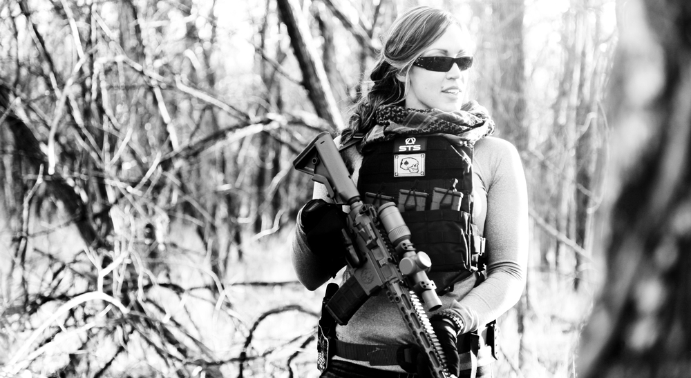 Brittany Paus with the SFA-15 RDR (Reduced Recoil Rifle) TAG vest.