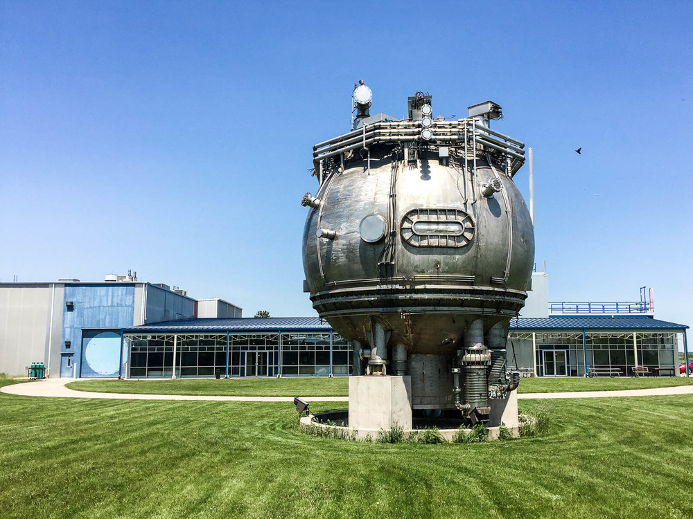 The 15 foot bubble chamber now sits outside Fermilab's detector development lab.