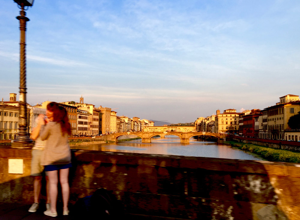 Upriver from the  Alla Carraia  bridge (1218): the  Santa Trinita bridge  (1252), and beyond, the  Ponte Vecchio  (A.D. 50 ?).  The crew left  Peregrinus  at anchor in Pisa and took the train to Florence to visit the seaman's alma mater.  8:11 PM 25 July; iPhone 6 Plus.