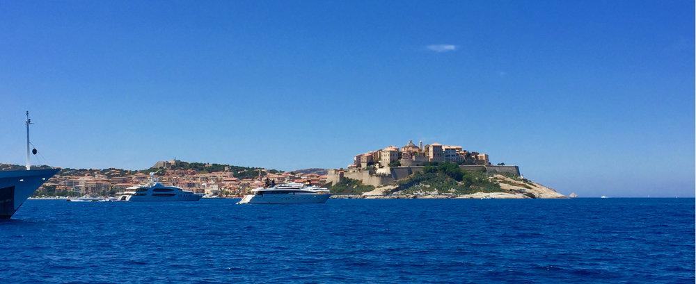 Calvi from  Peregrinus  at anchor in the Golfe de Calvi. 3 August 2016, iPhone 6 Plus.