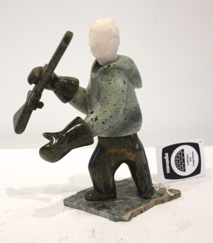 Hunter with Rifle<br>7 x 4.5 x 4<br>Serpentine and Marble<br>$ 625