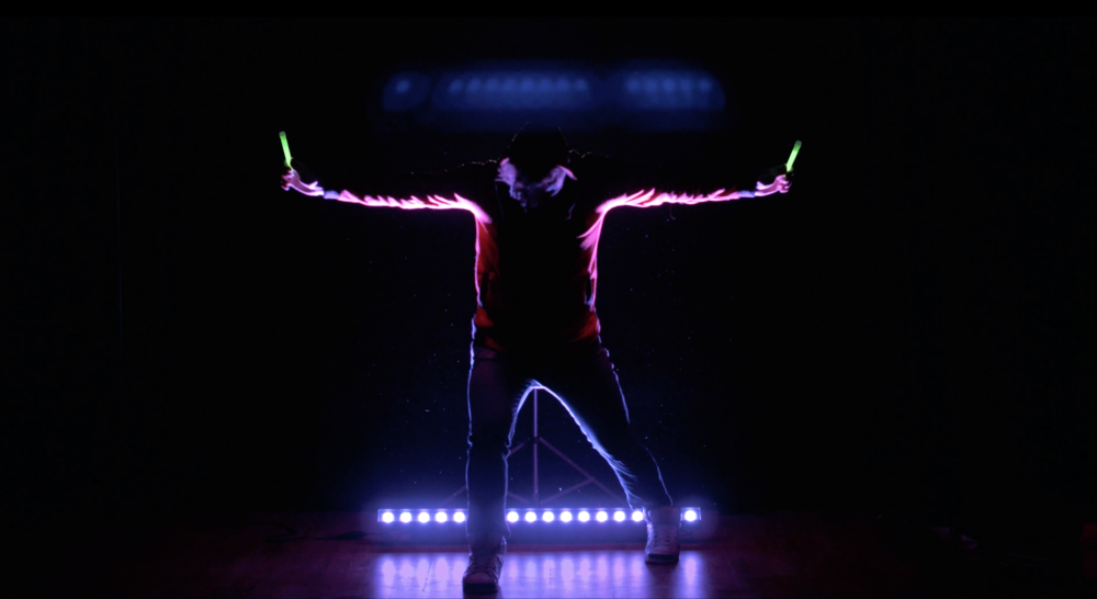 Rory glowsticks arms outstretched.png