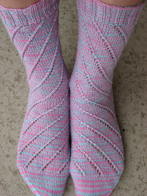 Spiral Eyelet Socks from Sandi Rosner are lovely and simple to knit, to show off our fabulous bright colorway.