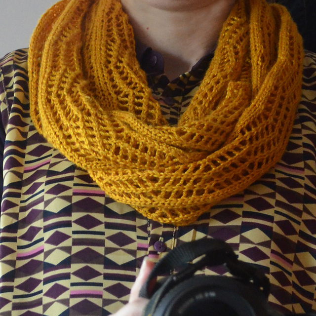 This Chevron Lace Cowl by Sarah Neal looks complicated, but is actually very simple to make. Available as a free Ravelry download. (I've got half a mind to figure out a similar pattern in crochet, any interest?)