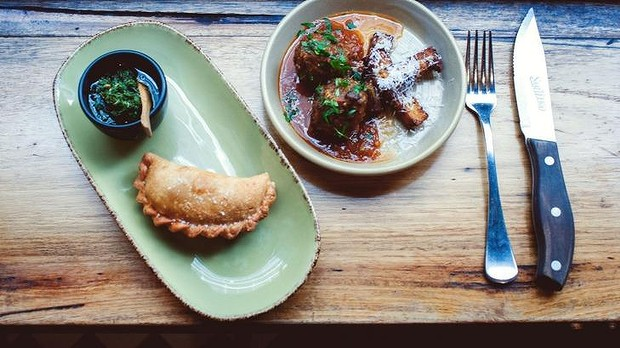 Sage and beef meatballs with tomato sugo and polenta pecorino fries, and lamb, prosciutto and broccoli empanada at San Telmo.  IMAGE: supplied
