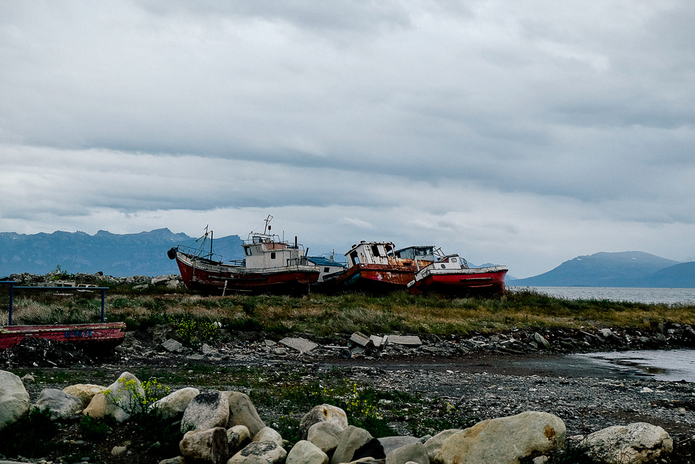 We spent a couple of days in Puerto Natales, a primary transit point for entering the National Park - Torres Del Paine. Down by the docks is a small graveyard of decommissioned boats against a backdrop of mountain peaks.