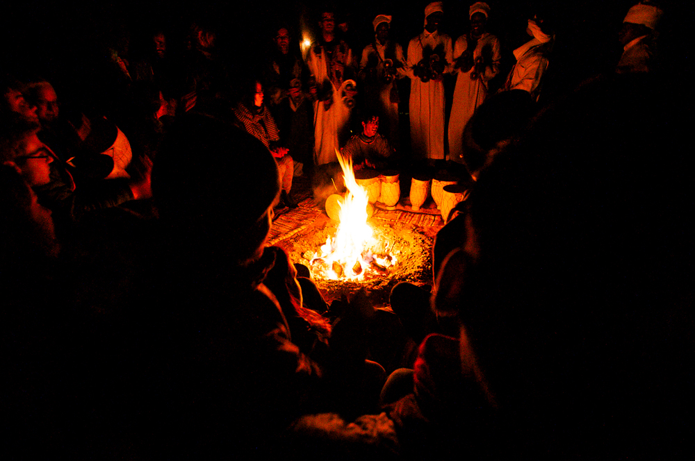 Everybody gathered around the bonfire in the middle of camp.